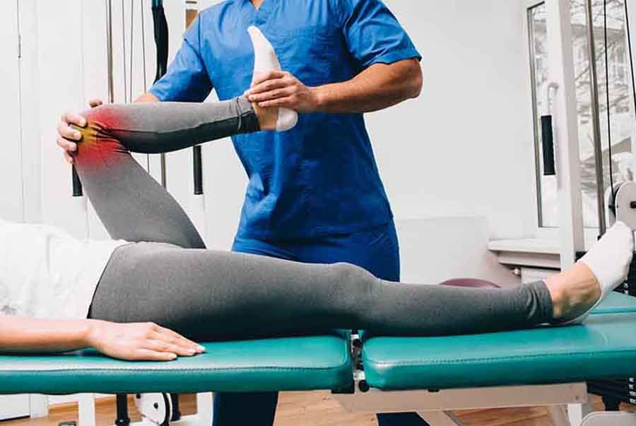 Singapore physio stretching out patient's inflammed knee