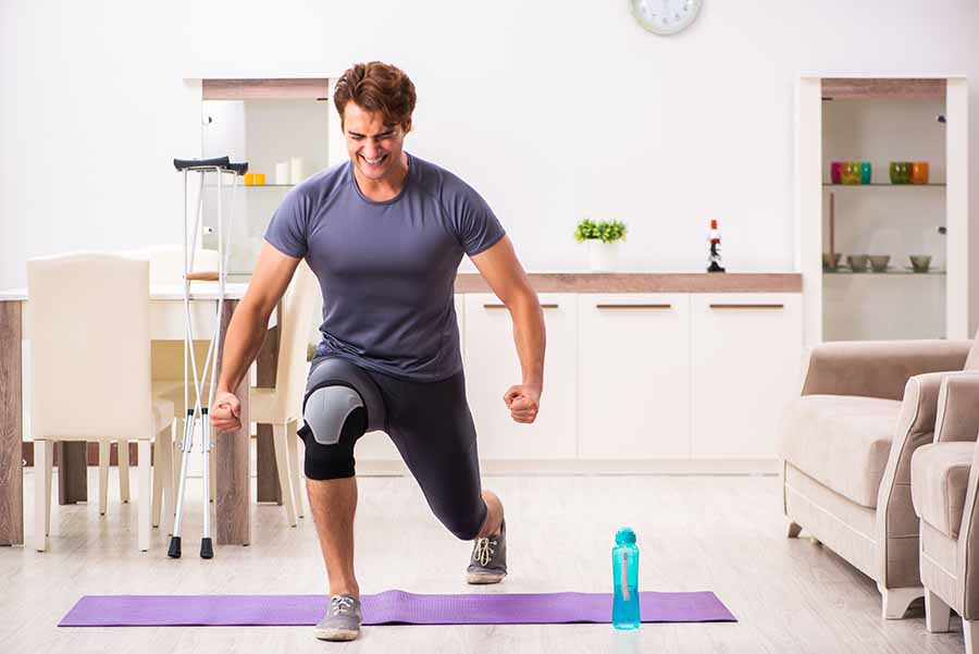man performing knee excercises for injury rehabilitation